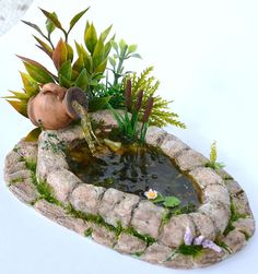 Dollhouse miniature garden pond dollhouse garden pond fairy garden koi pond plantdecor homedecor minigarden striped gourd house efairies com Fairy Garden Houses, Gnome Garden, Garden Ponds, Fairy Gardening, Fairies Garden, Koi Ponds, Gardening Tips, Jardin Decor, Fairy Furniture