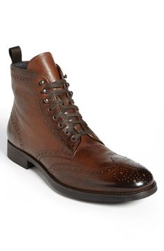 Free shipping and returns on To Boot New York 'Brennan' Wingtip Boot at Nordstrom.com. Richly burnished leather lends an antique feel to a sharp boot clad in classic wingtip paneling. Lacing grommets switch to hooks at the shaft to further the vintage appeal.