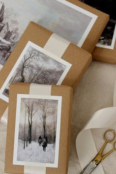 gift wrapping idea: The 10 Most Gorgeous Christmas Gift-Wrapping Ideas on Pinterest via @PureWow ... archival look with brown paper and wide white ribbon wrap topped with photos/post cards of winter scenes ...