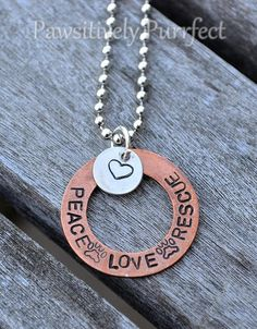 "Say it loud and say it proud! This beautiful necklace is made with a 1"" copper washer handstamped with a special message and accented with a handstamped silver heart. It is on a 24"" silver ball chain. 10% of the proceeds will go to a local animal rescue group."
