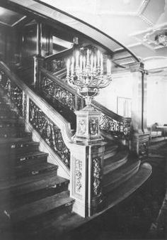 Photograph of the Olympic's (the Titanic's sister ship) Reception Room landing of the First Class Grand Staircase at D-Deck. In the foreground is a decorative candelabra which would have been nearly identical to the one on Titanic.