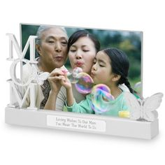 """Mom Float Frame, $24.99: For home or office, here's how to show the world who holds a very important place in your life. Give this classic """"Mom"""" frame as a birthday, Mother's Day or Holiday gift! Each holds a favorite 4"""" x 6"""" photo. Add a name and a few heartfelt words to the engraving plate to make this gift speak for you each time it's admired."""