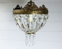 French Antique Crystal Prisms and Brass Chandelier by LaLoupiote