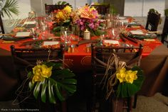 """tablescapes with tropical flowers   Festive and dramatic """"Latin Barbecue"""" with tropical flowers and leaves"""
