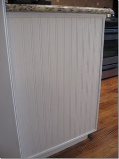 beadboard wallpaper at the end of a cabinet