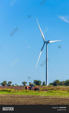 Wind turbine with a tractor in Kansas.
