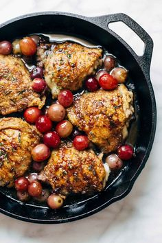 Skillet Chicken with Grapes and Caramelized Onions - an easy recipe that goes perfectly with a crisp green salad, quinoa, or fresh bread! Made with chicken, grapes, red wine, onions, and spices. | pinchofyum.com