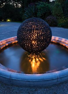 A tantalising, perfect garden sphere of black puddle stones, washed smooth by centuries of gentle erosion in river water by David Harber Garden Spheres, Garden Fountains, Water Features In The Garden, Garden Features, Moon Garden, Water Garden, Night Garden, Landscape Design, Garden Design