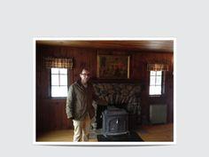 stone fireplace with wood burning stove insert