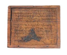 Roman writing tablet, AD 80-120. Wax on wood. Museum of London.