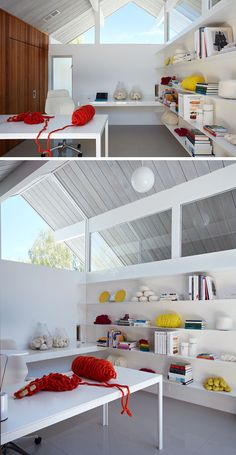 Inside this home office, there's plenty of light from the windows and floating shelves provide plenty of storage.