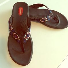 Okabashi Flip Flops Okabashi flip flops, these are marked as a large, made in U.S.A, I wear a nine and these fit me, their size chart says a large fits womens 9.5-10.5 Okabashi Shoes Sandals