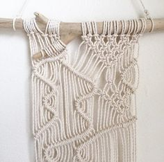 This macrame wall hanging is hand-made by Hanifah Tohir in Sydney, Australia. This piece is unique as the design was made with free movement of lines. It will hang nicely amongst other small wall hangings in a cluster to fit a small wall.   Measurements: Lenght:  38cm  Height: 50cm