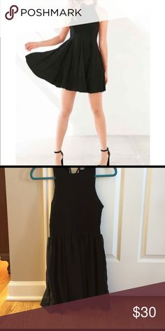 Little black dress, mock neck. Worn only twice, tie neck, fitted top with flow skirt. Kimchi Blue Dresses Mini
