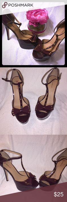 """T-Strap peep toe heels New! Gold studded patent leather burgundy peep toe sandals with bow accent....heel height approx: 5 1/2"""" platform approx: 1 1/2""""....these are a must have!!! Shoes Heels"""