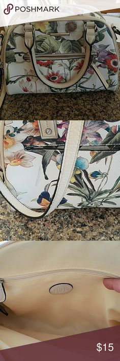 Dana Buchnan handbag This beautiful spring handbag is in good condition, strap is slightly worn and small smug on back side. Bag has side zipper pocket and open pocket on the other side with two zipper compartments. Dana Buchman Bags Shoulder Bags