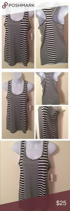 NWT Black/White Workout Tank Top Just Listed: NWT Performance Workout Tank Top   Color: Black/White Stripes    Condition: NWT  ❌Trades❌  ⚡️I ship lightening fast⚡️  🎉Discounts with bundles🎉 Hannah Tops Tank Tops