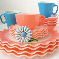 I do not care for Pyrex, glassware or dishes.  I would KILL for this set of pink ruffled dishes though.