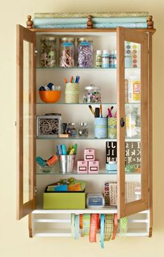 Organize Your Sewing Room | AllPeopleQuilt.com  OR any room.  Love the glass doors to see what you have.