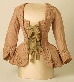 Pet-en-l'air jacket, 1780-90    British informal sack-jacket or pet-en-l'air in  undyed cotton, roller-printed with an all-over Stormont pins  design in pinky brown. Entirely hand stitched. Reputed to have  belonged to Mrs David Garrick, wife of the celebrated actor