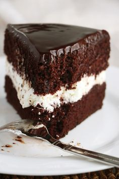 Tuxedo Cake - moist chocolate cake layers, whipped cream filling, and topped with chocolate ganache