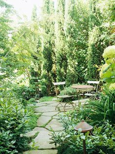Lush shrubs make for a cozy garden retreat. More solutions for small yards: http://www.bhg.com/gardening/landscaping-projects/landscape-basics/simple-solutions-for-small-space-landscapes/?socsrc=bhgpin060812