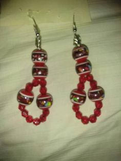 Their vibrant tone of red is an absolute jaw dropper. Wear these hot tamales out on the town and youre bound to have admiring eyes fall upon their Eastern European elegance Tamales, Festive, My Etsy Shop, Drop Earrings, Elegant, Check, Red, How To Wear, Shopping