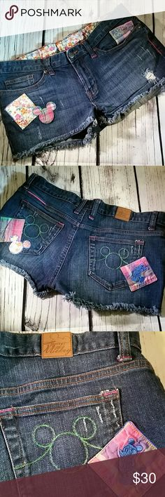 Cute Disney Parks Mickey distressed denim shorts. I love the details of the embroidered Mickey, the patch work design and the way they distressed these Daisy Duke style, denim blue jean shorts. Zipper fly with Disney embossed in the button and leather House of Mickey patch on the back waist of these shorts. Disney  Shorts Jean Shorts