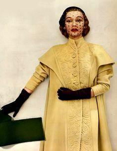 1951 Sophie Malgat in Milliken wool cape-coat with push-up sleeves by Don Loper of California, hat by Irene of New York, Harper's Bazaar
