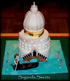 Amazing Italy theme cake with basilica, Michelangelo edible picture, Rome, coliseum, Venice and gondola topper. All the cake topper are made with marshmallow fondant.