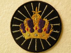 Whether you are celebrating the birth of the new Royal, or just feel like a Royal yourself, this crown is stitched on black twill with silver