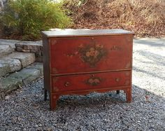Early American country pine lift top one drawer blanket chest in old red paint c1820. Excellent condition with wonderful old painted surface depicting flowers in a vase and fan design corners. Measures 43 inches wide by 13  inches deep and 36.5 inches high. The color of this piece is absolutely delicious. A decorators dream, just in from a CT estate.