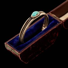 The Piece Age Circa: Antique Native American C. 1960s Markings: Unmarked, Tested, Guaranteed Country of Origin: United States - Navajo Nation Brand: Unknown Gram Weight: 17.1 Grams Metal Type: .925 Sterling Silver Material: -- Main Stone: Turquoise Main Stone