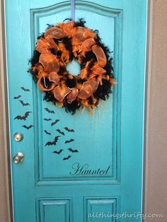 """I like the bats on the door and the word """"HAUNTED"""" - cute!"""