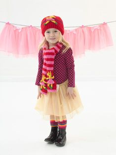 A knit hat perfect for the child who loves tutus and ballet lessons. Make the matching scarf, sweater, and afghan for a complete set.