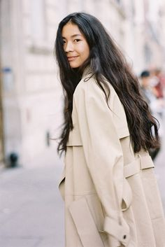 by Vanessa Jackman. Trench coat/long hair.