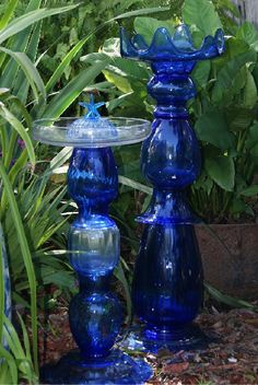 How to use cobalt glass indoors and out in the garden . Cobalt reflects light wonderfully, one reason we lo Garden Totems, Glass Garden Art, Cobalt Glass, Clear Glass Vases, Cobalt Blue, Sea Glass, Water Glass, Garden Whimsy, Blue Garden
