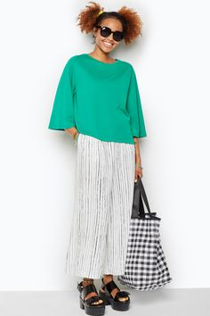 A clean and simply sleek top that meets your elbows with a little flared excitment! Dropped shoulder for a hang loose look.