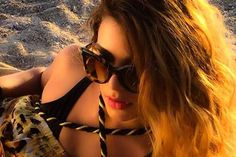 """Eleftheria hits the beach in music video for """"Hot Nights"""""""