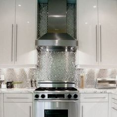 Your backsplash can be like a snazzy pair of Laboutin pumps that adds the sass and glam to the space....a great website for affordable metal backsplashes like this is www.glasstilestore.com (look under metal tiles!