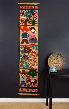The burlap panel is a tourist piece, and as utterly charming as anything I've come across in all my travels. Burros, babies, birds, flowers, campesinos, and cacti, all depicted in vibrant yarn. The cl