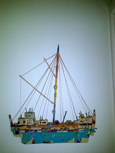 Beautiful ship made from scrap wood and old nails.