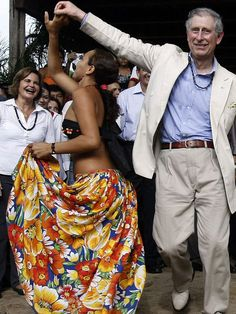 3/15/2009: Prince Charles dances with a local girl at Maguari Village in the Amazon Rainforest (Manaus, Brazil)