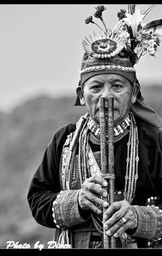 A Paiwan and his twin-pipe nose flute.  Taiwan is the only place where the twin-pipe nose flutes are still played.