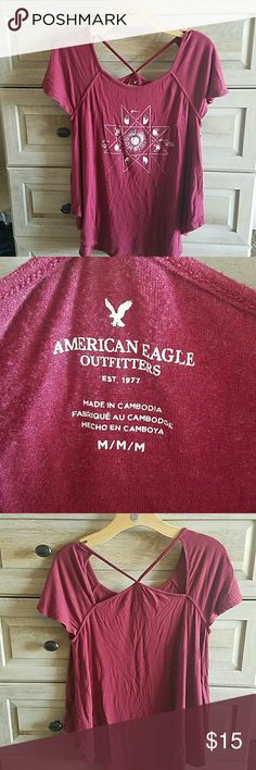 American Eagle T Maroon graphic tee shirt with cut out detail in the back. Curved hem and flowy fit. Worn once. American Eagle Outfitters Tops Tees - Short Sleeve