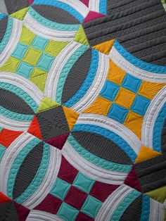 I love the quilting pattern in the nine patch area. It totally changes the look of the quilt!