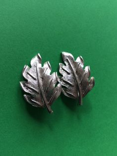 A personal favorite from my Etsy shop https://www.etsy.com/listing/503002668/vintage-kramer-silver-clip-on-leaf