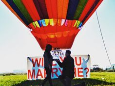 "This hot air balloon proposal is so creative and fun! They were hundreds of feet above the ground, and when she looked down, there was a sign asking, ""Will You Marry Me?"""