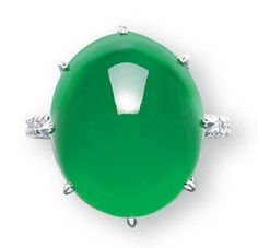 A JADEITE, DIAMOND, RUBY AND SAPPHIRE RING   Set with a thick high domed oval jadeite cabochon of bright emerald green colour and high translucency, to the ruby and sapphire gallery and the diamond-set hoop, mounted in platinum, cabochon approximately 17.6 x 14.7 x 10.9 mm, ring size 5¼. Price realized: 2,180,000 HKD (USD 282,156)