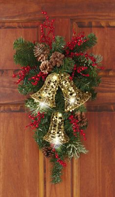 Holiday Bells Evergreen Swag Door Decor - Vertical evergreen floral swag features white lights that dazzle Link Christmas Door Decorations, Christmas Arrangements, Christmas Swags, Christmas Bells, Holiday Wreaths, Rustic Christmas, Christmas Holidays, Christmas Ornaments, Christmas Projects